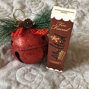 Too Faced Gingerbread Man Lipstick.